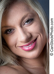 Sensual Looking Blond with green eyes, smling