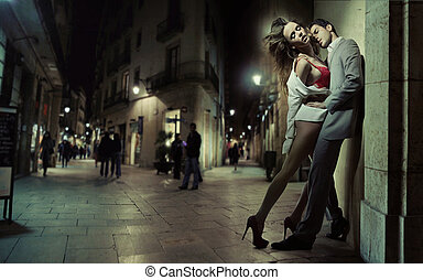 Sensual loving couple kissing in the dead of the night -...