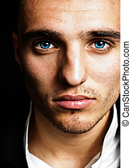 Sensual man with blue eyes - Closeup portrait of sensual man...
