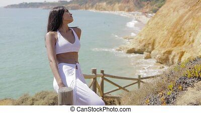 Sensual model posing on tropical viewpoint