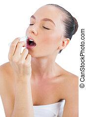 Sensual model putting lip balm on