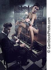 sensual, mujer, en, ropa interior atractiva, sentado, en, un, piano