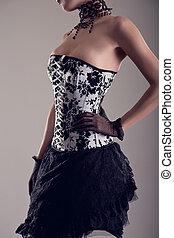 sensual, mujer joven, en, negro y blanco, corsé, con, floral, golpeteo