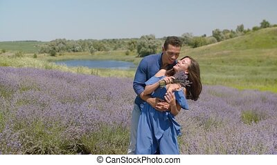 Sensual multiethnic couple embracing in field - Passionate...