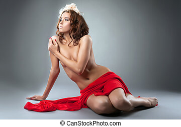Sensual naked beautiful woman posing in studio