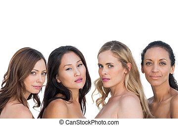 Sensual nude models posing and looking at camera on white...