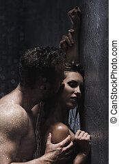 Sensual pair kissing - Sensual young pair kissing under the...
