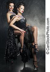 Sensual pair of women girlfriends hugging. Desire. Passion