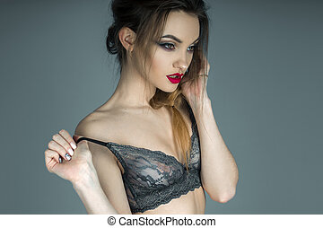 sensual portrait of glamour girl with red lips in beautiful lace
