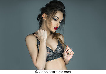 sensual portrait of pretty girl with red lips in beautiful lace