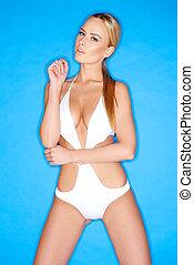 Sensual Pretty Blond Woman in White Swim Wear