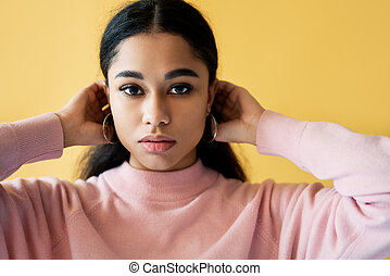 Sensual pretty woman portrait on yellow background