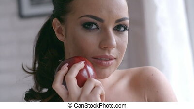 Sensual Pretty Young Woman Holding Red Apple
