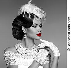Sensual red lips. Elegant retro woman portrait with fashion jewelry set. Black and white vintage photo.