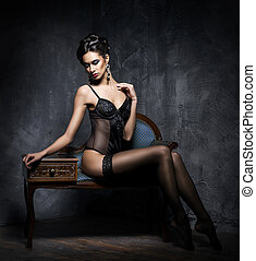 Sensual seductive young woman with sexy legs in hosiery...