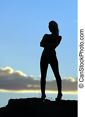 Sensual silhouette in the desert at sunset