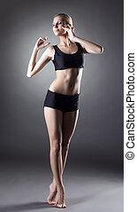 Sensual slender girl posing standing on tiptoe - Sensual...