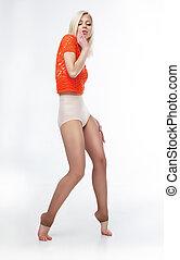 Sensual slim blonde girl posing in studio
