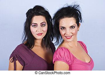 Sensual two brunettes women portrait
