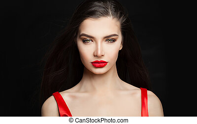 Sensual woman brunette with dark straight hair and red lips makeup on black background