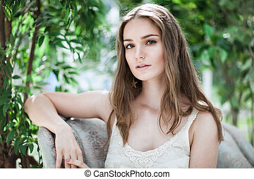 Sensual Woman Fashion Model on Green Leaves Background