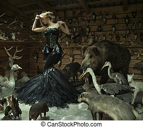 Sensual woman in a locked room full of wild animals