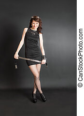 woman in black dress with belt