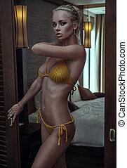 Sensual woman in her bedroom