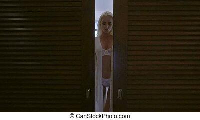 Sensual woman in her bedroom - Sensual blonde woman in white...
