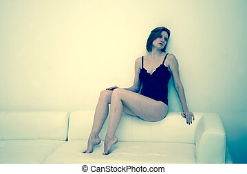 woman in lingerie on a sofa