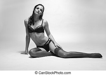 Sensual Woman in Lingerie Sitting on the Floor