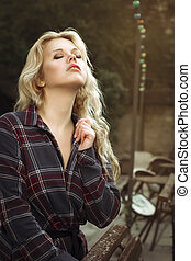 Sensual woman in unbuttoned shirt at the street