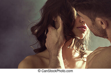 Sensual woman kissing her husband - Sensual woman kissing...