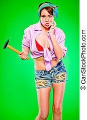 Sensual woman licking fingers struck by hammer. Pin-up and retro style .