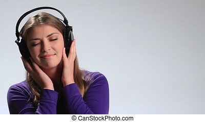 Sensual woman listening music in headphones