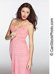 Sensual woman model in pink dress