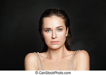 Sensual woman model with clear healthy skin on black background