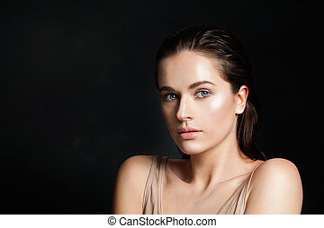 Sensual woman on black background, portrait