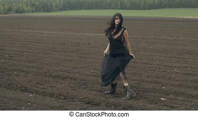 Sensual woman posing in black dress