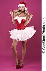 Sensual woman posing on pink background