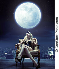 Sensual woman relaxing under the moon light - Sensual young...
