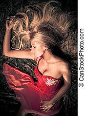 sensual woman - sensual blond woman in red dress studio shot