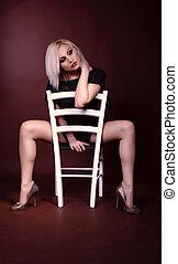 Sensual woman sitting on a chair