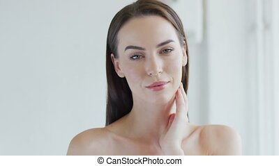 Sensual woman touching face