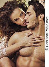 Sensual woman touching her boyfriend's perfect body