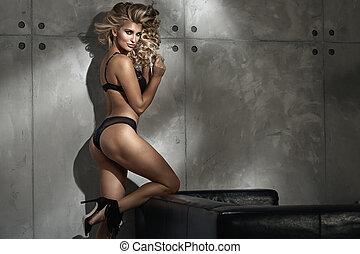 Sensual woman wearing black lace underwear