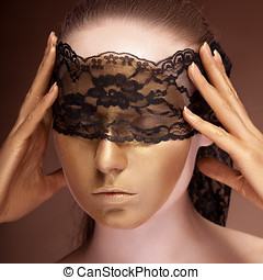 Sensual woman with a lace on face