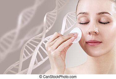 Sensual woman with cotton disk among DNA chains.