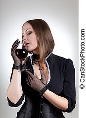 Sensual woman with glass of red wine