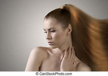 sensual woman with hair melting in paint